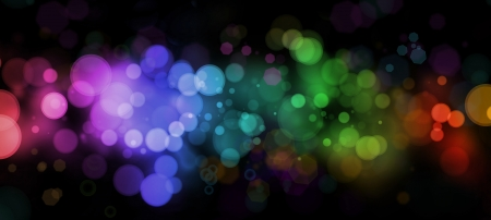 holiday lights: Abstract color blurs on dark background