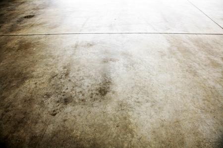 parking lot interior: Closeup of brown grungy floor