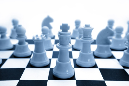 Chess pieces on board. Copy space