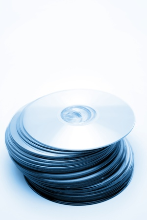 discs: Stack of compact discs on plain background  Stock Photo