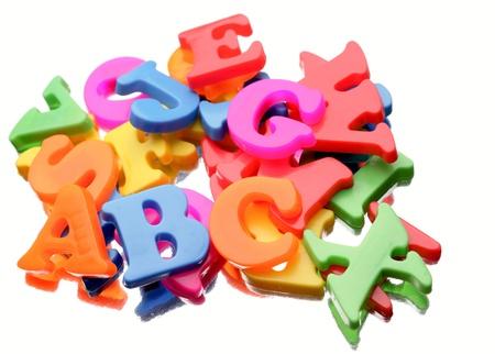 jumbled: Alphabet letters on plain background Stock Photo