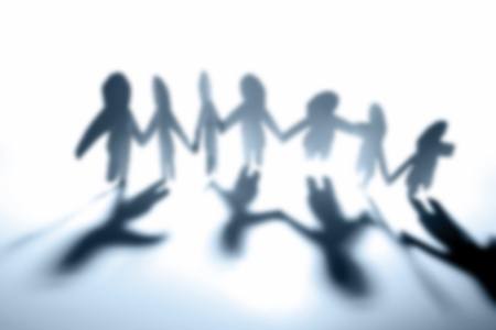 mankind: Group of people holding hands, out of focus Stock Photo