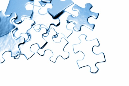 scattered: Jigsaw puzzle pieces on plain background Stock Photo