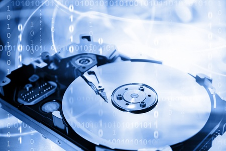 disco duro: Equipo duro y c�digos binarios Foto de archivo