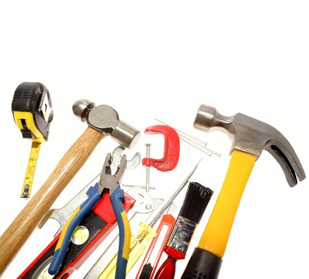 Varied tools on plain background. Copy space