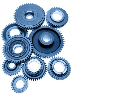 Steel gears meshing together on plain background photo