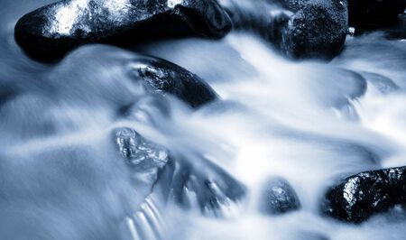rushing water: Stream and rocks. Blue tone Stock Photo