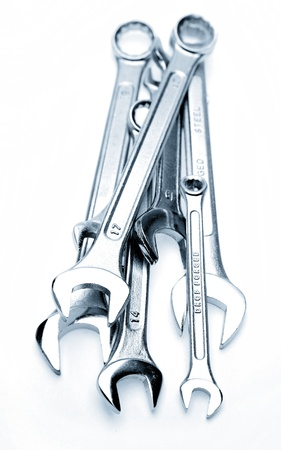 spanners: Pile of spanners on plain background Stock Photo