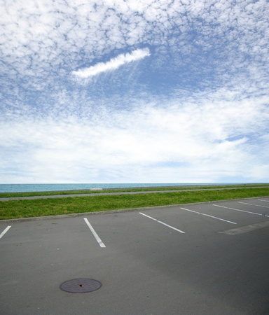 parking space: Parking lot and dramatic sky at seaside Stock Photo