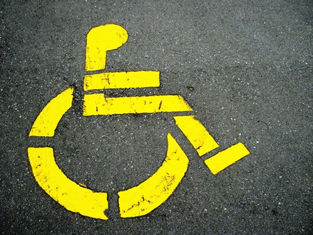 Handicapped symbol on parking space photo
