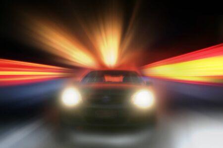speeding: Car speeding towards camera, bright background
