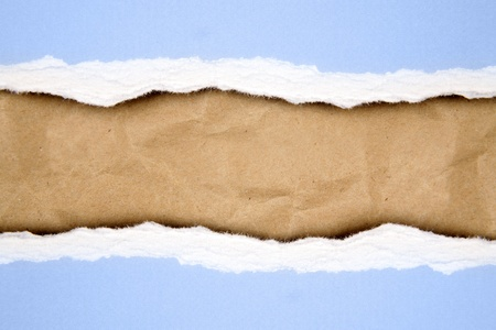 Ripped paper on brown background Stock Photo - 11531743