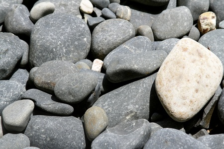 Closeup of assorted smooth stones photo