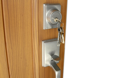 locksmith: Keys in lock of open door