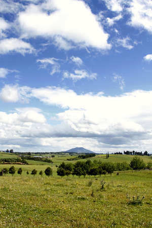 Green farmland and blue sky. Stock Photo - 11531833