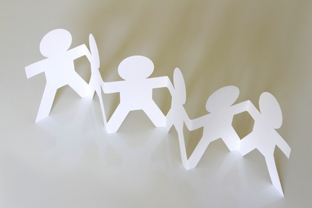 Group of paper chain people holding hands photo