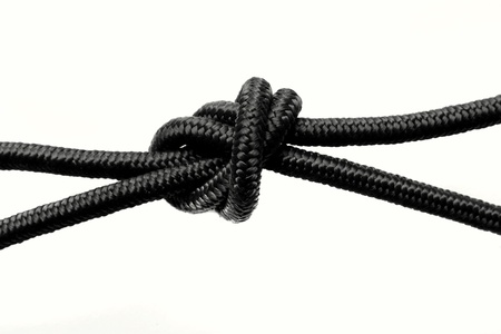 knotting: Knot in rope over white
