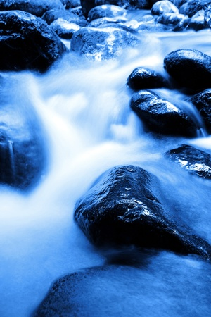 rushing water: Fast flowing rocky stream