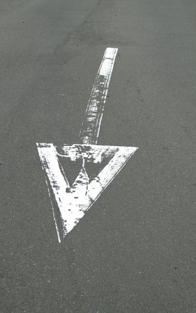 Arrow painted on road                    Stock Photo - 11856675