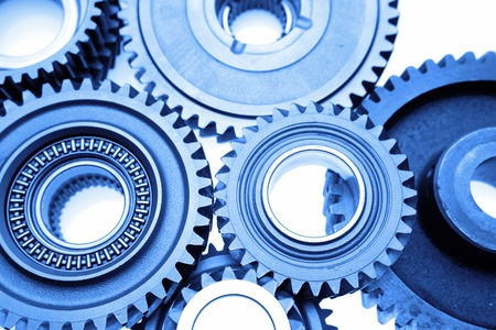 interlink: Closeup of steel gears meshing together