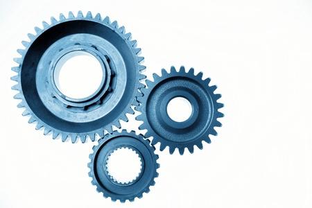 rueda dentada: Tres engranajes de metal de m�s de blanco