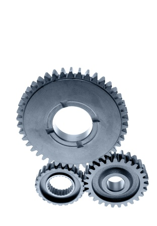 Three cogs on plain background photo