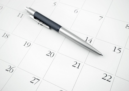 Pen on a calendar page photo