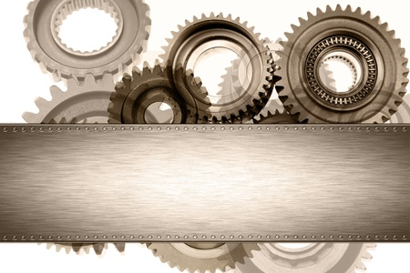 Steel panel on cogs. Copy space photo