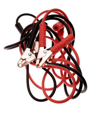 Jumper cables on plain background photo