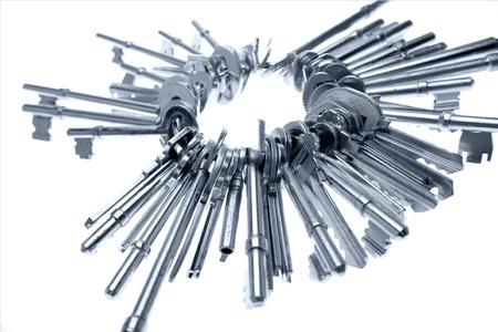 Bunch of keys on white Stock Photo
