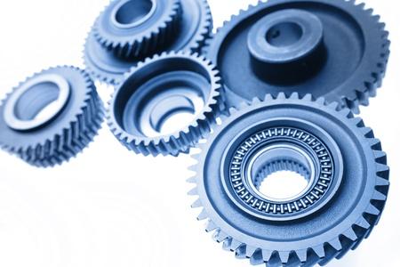 Group of cogwheels binding together photo
