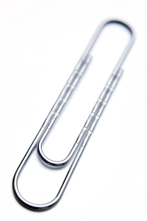 paperclip: Paper clip on plain background