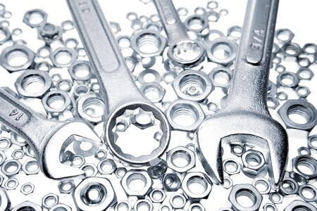 spanners: Wrenches on nuts