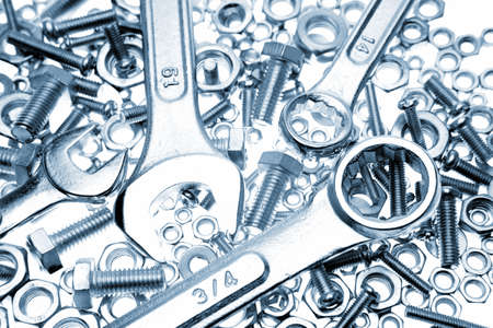 metal fastener: Spanners on nuts and bolts Stock Photo