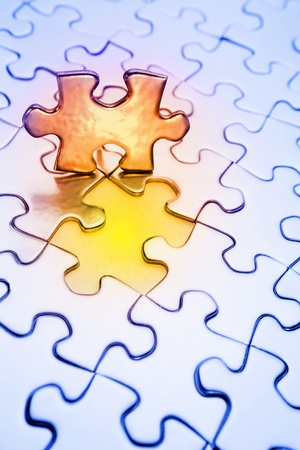 Last piece of jigsaw puzzle to complete photo