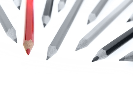 One red pencil standing out from dull pencils photo