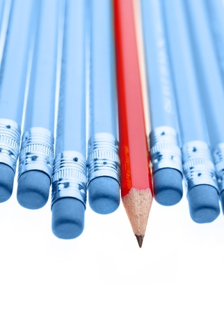 One red pencil standing out from dull pencils Stock Photo