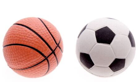 sport balls: Basketball and football on plain background
