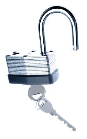 unleash: Padlock and keys on plain background Stock Photo
