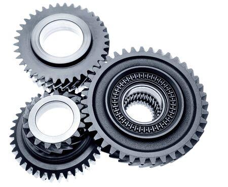 Three metal gears on plain background Stock Photo - 12196014