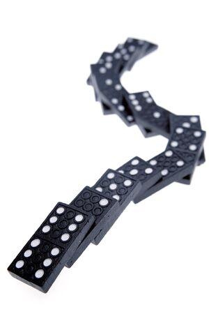 failed strategy: Fallen dominoes on plain background Stock Photo