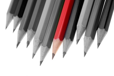 standout: One red pencil standing out from dull pencils Stock Photo