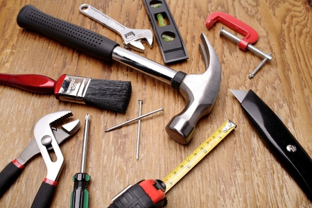 carpentry tools: Assorted work tools on wooden panel Stock Photo