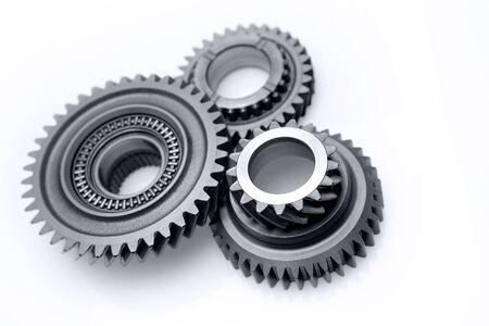 three wheel: Three metal gears on plain background Stock Photo