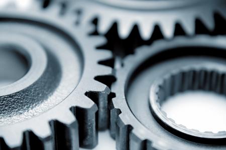 gears: Primer plano de tres engranajes de metal Foto de archivo
