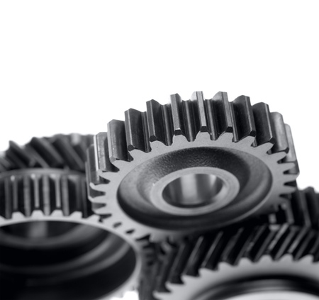 Closeup of steel gears meshing together photo