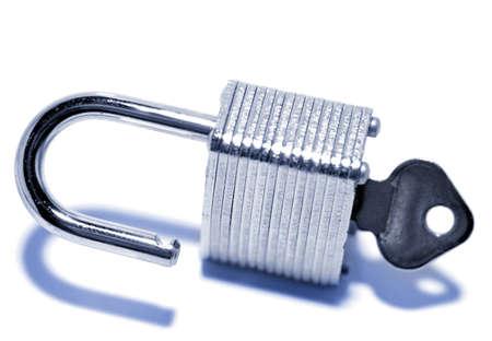 unleash: Padlock and key on plain background Stock Photo