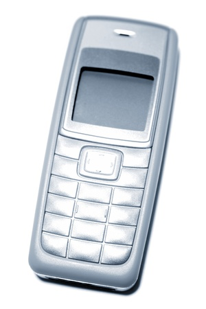 Old mobile phone on plain background photo