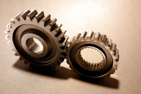 Two steel cogs together photo