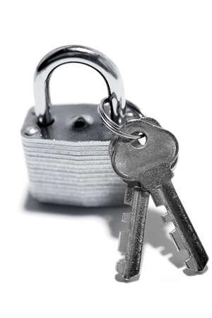 locksmith: Padlock and keys on plain background Stock Photo